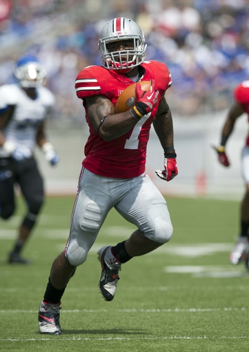 Aug 31, 2013; Columbus, OH, USA; Ohio State Buckeyes running back Jordan Hall (7) scores against the Buffalo Bulls at Ohio Stadium. Ohio State won the game 40-20. Mandatory Credit: Greg Bartram-USA TODAY Sports