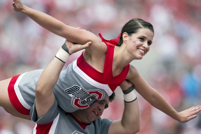 Aug 31, 2013; Columbus, OH, USA; Members of the Ohio State Buckeyes cheerleading squad entertain the crowd after a touchdown against the Buffalo Bulls at Ohio Stadium. Ohio State won the game 40-20. Mandatory Credit: Greg Bartram-USA TODAY Sports