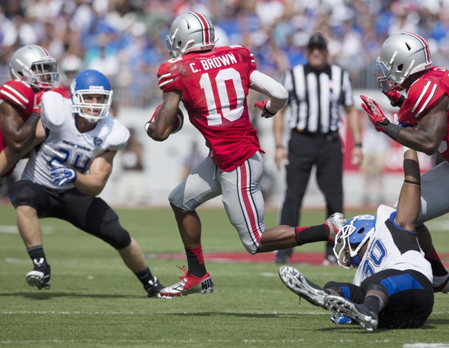 Aug 31, 2013; Columbus, OH, USA; Ohio State Buckeyes wide receiver Philly Brown (10) evades Buffalo Bulls defenders for a short gain in the 4th quarter at Ohio Stadium. Ohio State won the game 40-20. Mandatory Credit: Greg Bartram-USA TODAY Sports