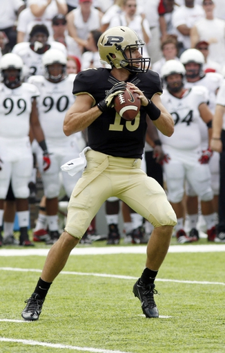 Aug 31, 2013; Cincinnati, OH, USA; Purdue Boilermakers quarterback Rob Henry (15) looks to throw a pass against the Cincinnati Bearcats during the first quarter at Nippert Stadium. Mandatory Credit: David Kohl-USA TODAY Sports