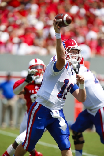 August 31, 2013; Raleigh, NC, USA;   Louisiana Tech quarterback Scotty Young (16) makes a throw against North Carolina State at Carter Finley Stadium. North Carolina State defeated Louisiana Tech 40-14. Mandatory Credit: James Guillory-USA TODAY Sports