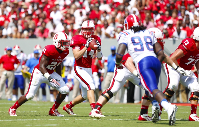 August 31, 2013; Raleigh, NC, USA;  North Carolina State quarterback Bryant Shirreffs (14) drops back to pass during the game against Louisiana Tech at Carter Finley Stadium. North Carolina State defeated Louisiana Tech 40-14. Mandatory Credit: James Guillory-USA TODAY Sports