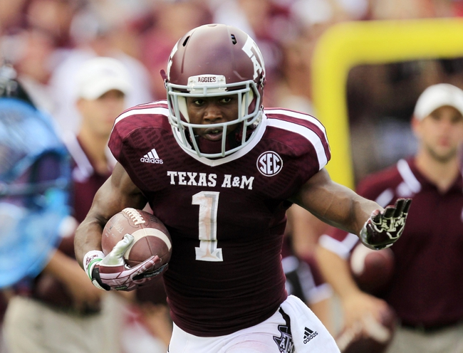 Aug 31, 2013; College Station, TX, USA; Texas A&M Aggies running back Ben Malena (1) rushes against the Rice Owls during the second half at Kyle Field. Texas A&M won 52-31. Mandatory Credit: Thomas Campbell-USA TODAY Sports