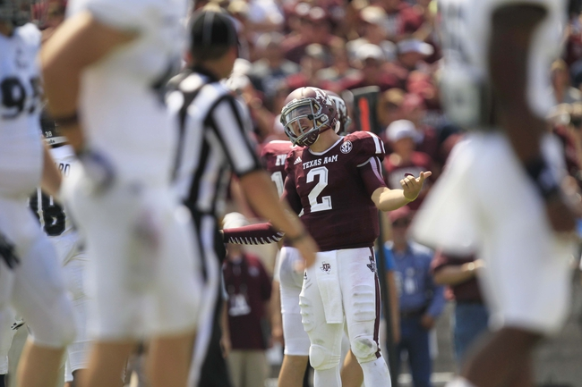 Aug 31, 2013; College Station, TX, USA; Texas A&M Aggies quarterback Johnny Manziel (2) reacts to taunting by the Rice Owls players resulting in an unsportsmanlike conduct penalty during the second half at Kyle Field. Texas A&M won 52-31. Mandatory Credit: Thomas Campbell-USA TODAY Sports
