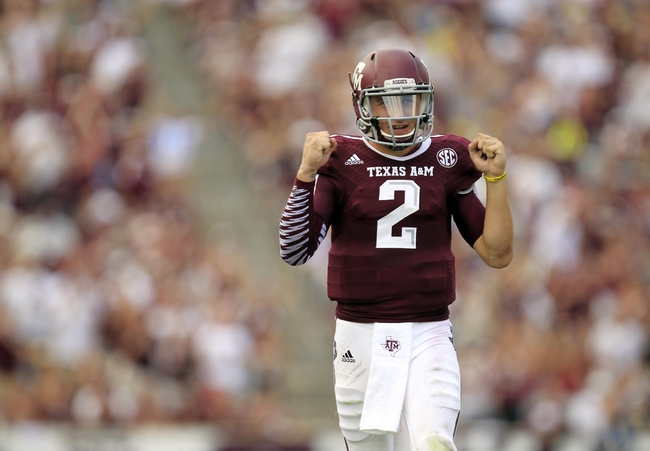 Aug 31, 2013; College Station, TX, USA; Texas A&M Aggies quarterback Johnny Manziel (2) celebrates after throwing for a touchdown against the Rice Owls during the second half at Kyle Field. Texas A&M won 52-31. Mandatory Credit: Thomas Campbell-USA TODAY Sports