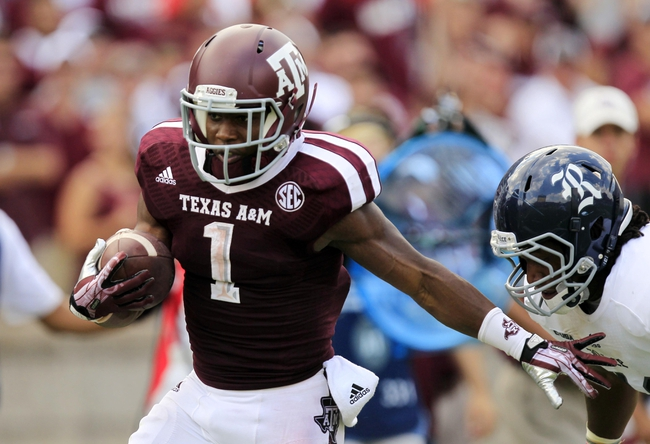 Aug 31, 2013; College Station, TX, USA; Texas A&M Aggies running back Ben Malena (1) carries the ball against the Rice Owls during the second half at Kyle Field. Texas A&M won 52-31. Mandatory Credit: Thomas Campbell-USA TODAY Sports
