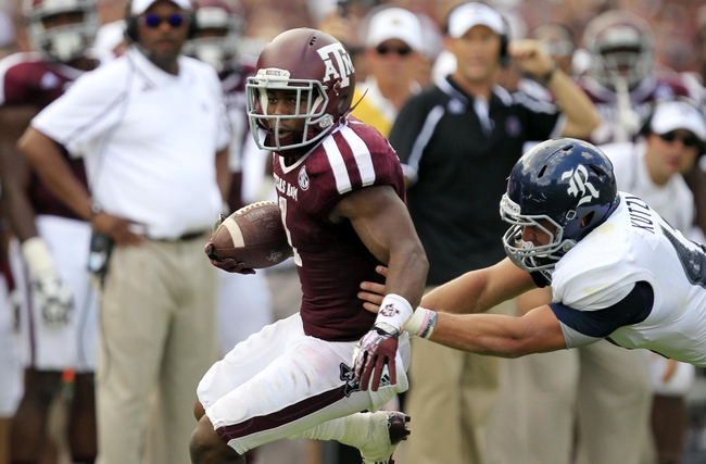 Aug 31, 2013; College Station, TX, USA; Texas A&M Aggies running back Ben Malena (1) rushes past Rice Owls linebacker Michael Kutzler (42) during the second half at Kyle Field. Texas A&M won 52-31. Mandatory Credit: Thomas Campbell-USA TODAY Sports