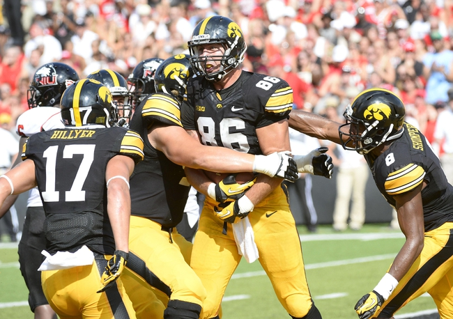 Aug 31, 2013; Iowa City, IA, USA; Iowa Hawkeyes tight end C.J. Fiedorowicz (86) reacts after catching a touchdown against the Northern Illinois Huskies during the second quarter at Kinnick Stadium. Mandatory Credit: Mike DiNovo-USA TODAY Sports