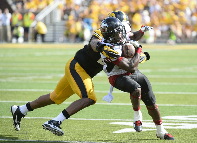 Aug 31, 2013; Iowa City, IA, USA; Northern Illinois Huskies wide receiver Tommylee Lewis (10) makes a catch against Iowa Hawkeyes linebacker Christian Kirksey (20) during the second quarter at Kinnick Stadium. Mandatory Credit: Mike DiNovo-USA TODAY Sports