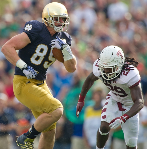 Aug 31, 2013; South Bend, IN, USA; Notre Dame Fighting Irish tight end Troy Niklas (85) catches a pass for a touchdown as Temple Owls safety Stephaun Marshall (29) defends in the second quarter at Notre Dame Stadium. Mandatory Credit: Matt Cashore-USA TODAY Sports