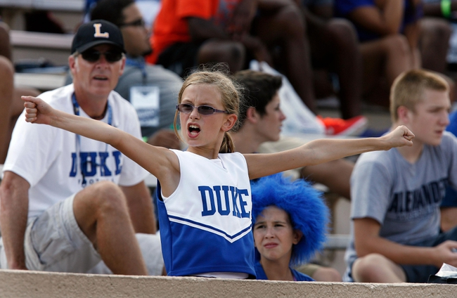 Aug 31, 2013; Durham, NC, USA; Duke Blue Devils fan Caraline Laffler cheers on her team against the North Carolina Central Eagles at Wallace Wade Stadium. Mandatory Credit: Mark Dolejs-USA TODAY Sports