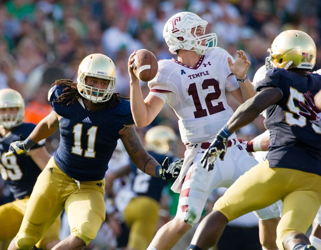 Aug 31, 2013; South Bend, IN, USA; Temple Owls quarterback Connor Reilly (12) throws under pressure from Notre Dame Fighting Irish linebacker Ishaq Williams (11) and linebacker Prince Shembo (55) in the third quarter at Notre Dame Stadium. Notre Dame won 28-6. Mandatory Credit: Matt Cashore-USA TODAY Sports