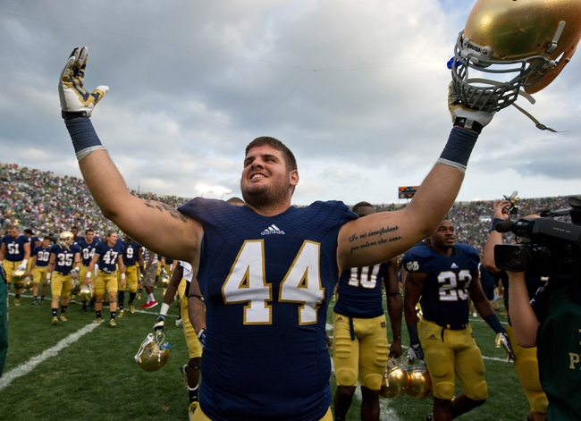 Aug 31, 2013; South Bend, IN, USA; Notre Dame Fighting Irish linebacker Carlo Calabrese (44) celebrates after Notre Dame defeated the Temple Owls 28-6 at Notre Dame Stadium. Mandatory Credit: Matt Cashore-USA TODAY Sports