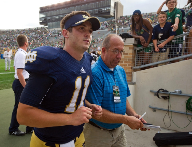 Aug 31, 2013; South Bend, IN, USA; Notre Dame Fighting Irish quarterback Tommy Rees (11) leaves the field after Notre Dame defeated the Temple Owls 28-6 at Notre Dame Stadium. Mandatory Credit: Matt Cashore-USA TODAY Sports