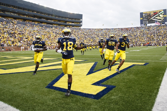 Aug 31, 2013; Ann Arbor, MI, USA; Michigan Wolverines defensive back Blake Countess (18) leads teammates over to the fan section after the game against the Central Michigan Chippewas at Michigan Stadium. Michigan won 59-9. Mandatory Credit: Rick Osentoski-USA TODAY Sports