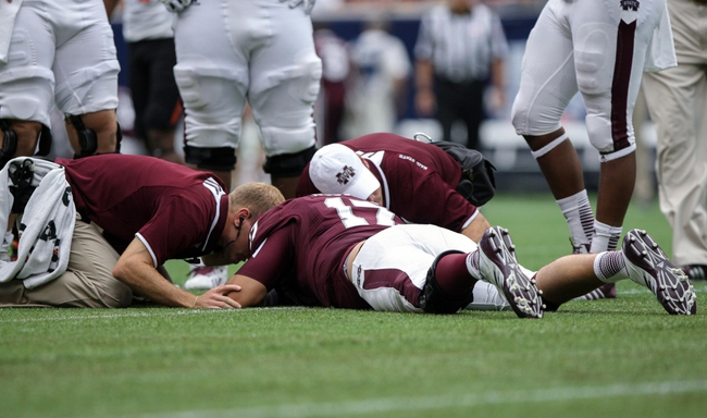 Aug 31, 2013; Houston, TX, USA; Mississippi State Bulldogs quarterback Tyler Russell (17) lies on the field after a play during the third quarter against the Oklahoma State Cowboys at Reliant Stadium. Mandatory Credit: Troy Taormina-USA TODAY Sports