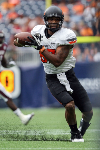 Aug 31, 2013; Houston, TX, USA; Oklahoma State Cowboys wide receiver Tracy Moore (87) makes a catch during the third quarter against the Mississippi State Bulldogs at Reliant Stadium. Mandatory Credit: Troy Taormina-USA TODAY Sports