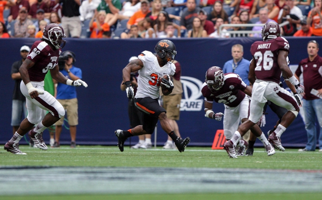 Aug 31, 2013; Houston, TX, USA; Oklahoma State Cowboys running back Jeremy Smith (31) runs with the ball during the third quarter against the Mississippi State Bulldogs at Reliant Stadium. Mandatory Credit: Troy Taormina-USA TODAY Sports