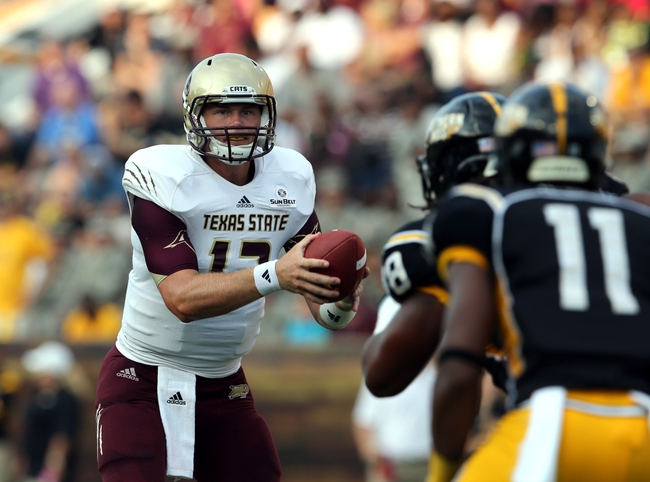 Aug 31, 2013; Hattiesburg, MS, USA; Texas State Bobcats quarterback Tyler Arndt (12) takes a snap in the first quarter against the Southern Miss Golden Eagles at M.M. Roberts Stadium. Mandatory Credit: Chuck Cook-USA TODAY Sports