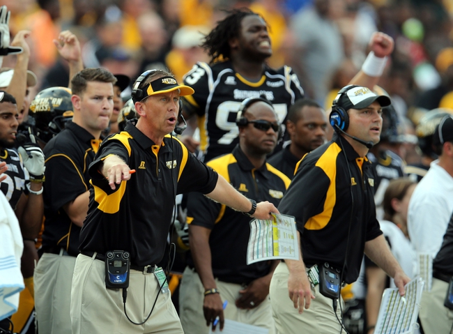 Aug 31, 2013; Hattiesburg, MS, USA; Southern Miss Golden Eagles head coach Todd Monken (left) signals after the Texas State Bobcats missed a first quarter field goal at M.M. Roberts Stadium. Mandatory Credit: Chuck Cook-USA TODAY Sports