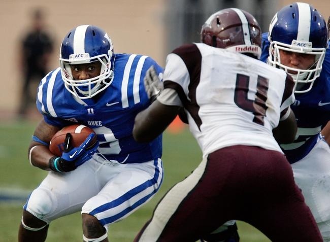 Aug 31, 2013; Durham, NC, USA; Duke Blue Devils running back Josh Snead (9) runs the ball against the North Carolina Central Eagles defense at Wallace Wade Stadium. Mandatory Credit: Mark Dolejs-USA TODAY Sports