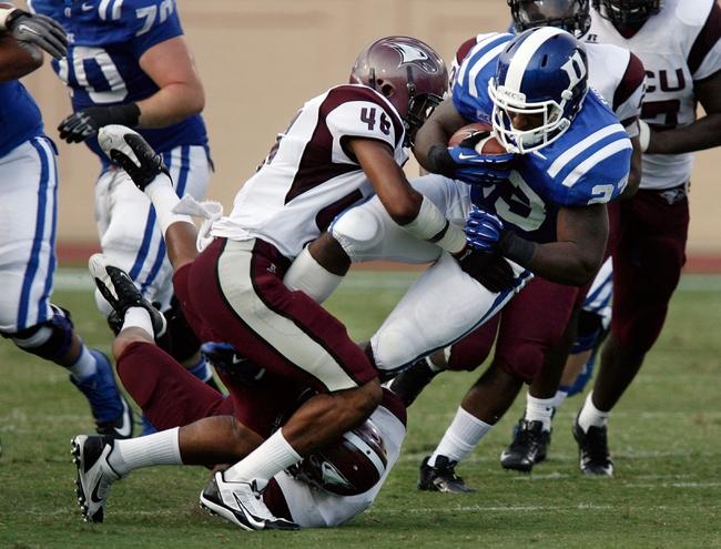 Aug 31, 2013; Durham, NC, USA; North Carolina Central Eagles defensive back Jamarius Quary (46) tackles Duke Blue Devils running back Juwan Thompson (23) at Wallace Wade Stadium. Mandatory Credit: Mark Dolejs-USA TODAY Sports