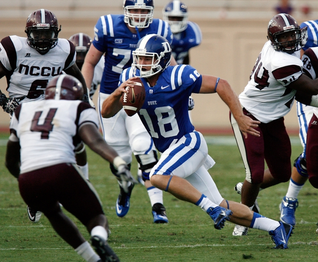 Aug 31, 2013; Durham, NC, USA; Duke Blue Devils quarterback Brandon Connette (18) scrambles against the North Carolina Central Eagles defense at Wallace Wade Stadium. Mandatory Credit: Mark Dolejs-USA TODAY Sports