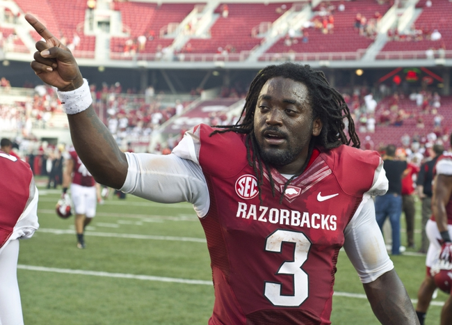 Aug 31, 2013; Fayetteville, AR, USA; Arkansas Razorback running back Alex Collins (3) walks off the field following a game against the Louisiana Ragin' Cajuns at Donald W. Reynolds Razorback Stadium. Arkansas defeated Louisiana 34-14. Mandatory Credit: Beth Hall-USA TODAY Sports