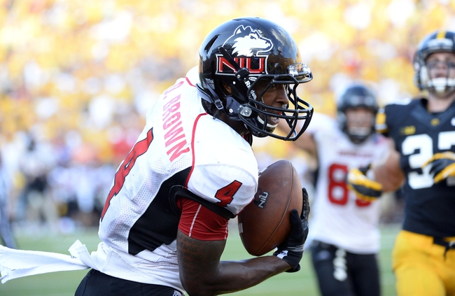 Aug 31, 2013; Iowa City, IA, USA; Northern Illinois Huskies wide receiver Da'Ron Brown (4) catches a touchdown against the Iowa Hawkeyes during the fourth quarter at Kinnick Stadium. Northern Illinois defeats Iowa 30-27. Mandatory Credit: Mike DiNovo-USA TODAY Sports