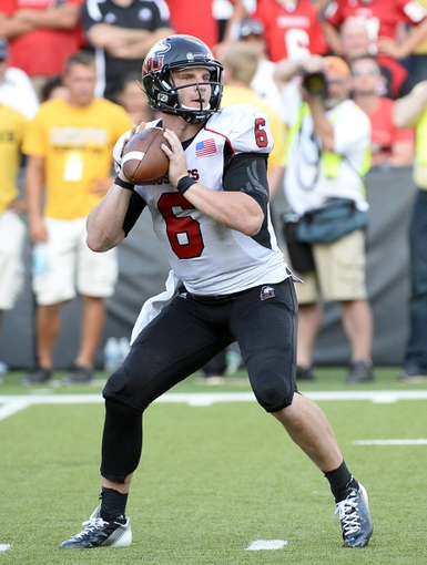 Aug 31, 2013; Iowa City, IA, USA; Northern Illinois Huskies quarterback Jordan Lynch (6) drops back to pass against the Iowa Hawkeyes during the fourth quarter at Kinnick Stadium. Northern Illinois defeats Iowa 30-27. Mandatory Credit: Mike DiNovo-USA TODAY Sports