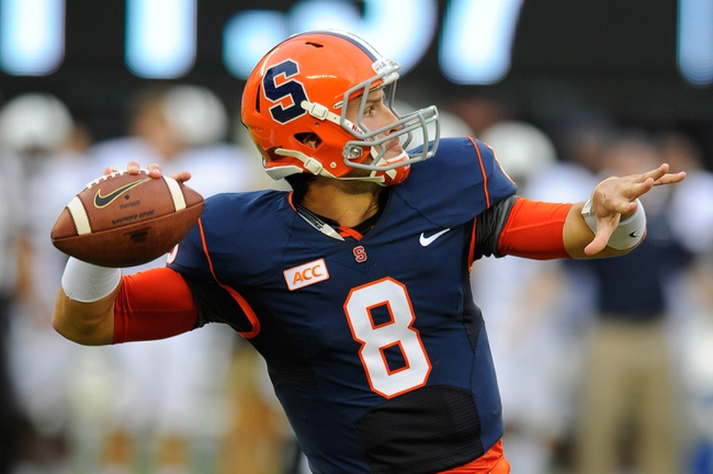 Aug 31, 2013; East Rutherford, NJ, USA; Syracuse Orange quarterback Drew Allen (8) drops back to pass during the third quarter against the Penn State Nittany Lions at MetLife Stadium.  Penn State defeated Syracuse 23-17.  Mandatory Credit: Rich Barnes-USA TODAY Sports