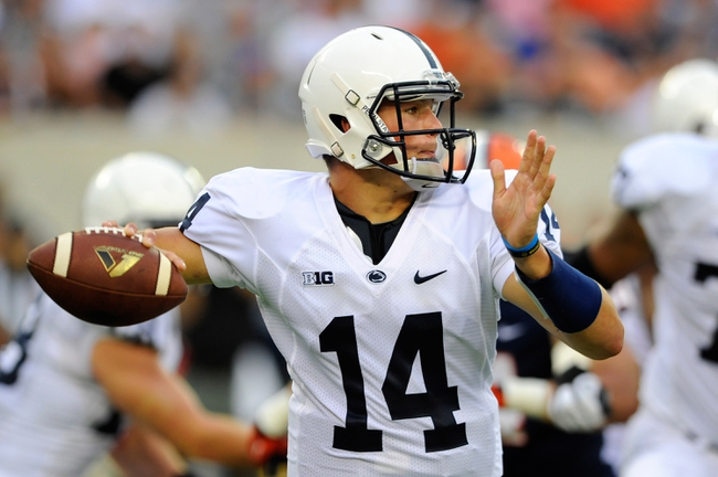 Aug 31, 2013; East Rutherford, NJ, USA; Penn State Nittany Lions quarterback Christian Hackenberg (14) prepares to throw the ball during the third quarter against the Syracuse Orange at MetLife Stadium.  Penn State defeated Syracuse 23-17.  Mandatory Credit: Rich Barnes-USA TODAY Sports