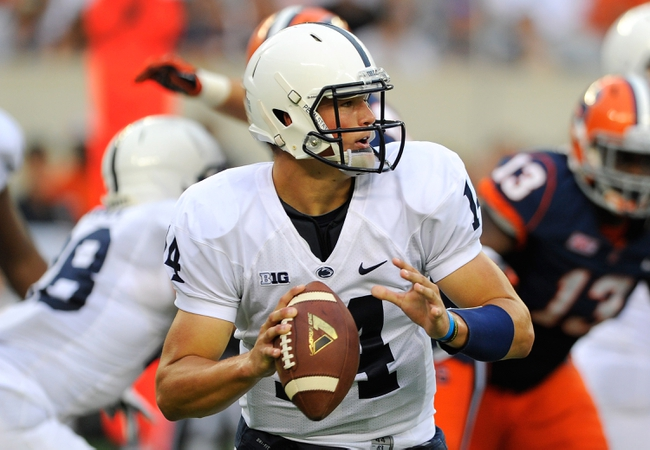 Aug 31, 2013; East Rutherford, NJ, USA; Penn State Nittany Lions quarterback Christian Hackenberg (14) scrambles out of the pocket during the third quarter against the Syracuse Orange at MetLife Stadium.  Penn State defeated Syracuse 23-17.  Mandatory Credit: Rich Barnes-USA TODAY Sports