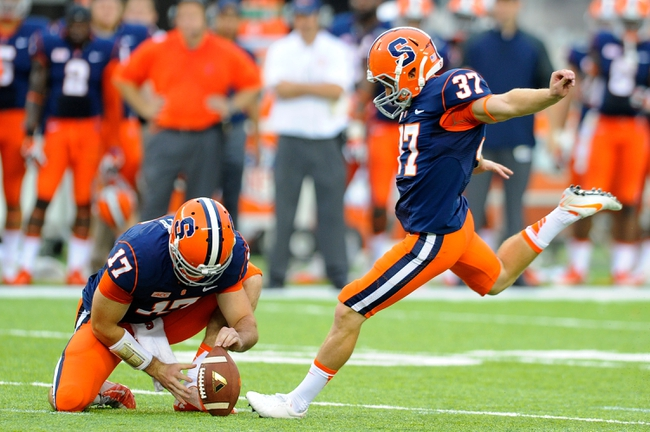 Aug 31, 2013; East Rutherford, NJ, USA; Syracuse Orange kicker Ross Krautman (37) prepares to kick a field goal from the hold of quarterback Charley Loeb (17) during the third quarter against the Penn State Nittany Lions at MetLife Stadium.  Penn State defeated Syracuse 23-17.  Mandatory Credit: Rich Barnes-USA TODAY Sports