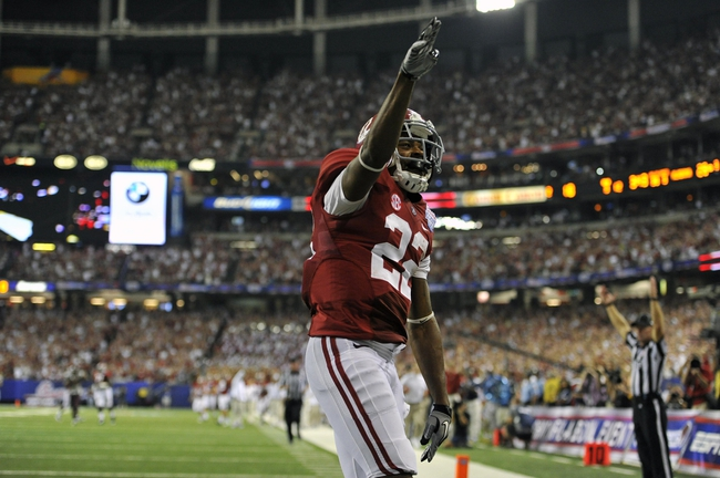 Aug 31, 2013; Atlanta, GA, USA; Alabama Crimson Tide wide receiver Christion Jones (22) celebrates a touchdown against the Virginia Tech Hokies during the third quarter of the 2013 Chick-fil-A Kickoff game at the Georgia Dome. Mandatory Credit: Paul Abell-USA TODAY Sports