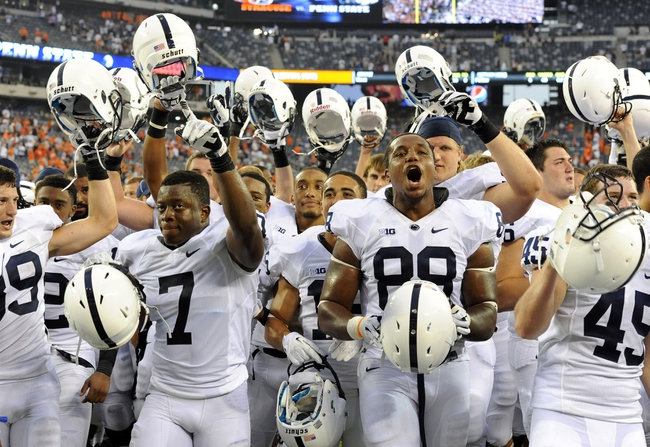 Aug 31, 2013; East Rutherford, NJ, USA; Penn State Nittany Lions players celebrate following the game against the Syracuse Orange at MetLife Stadium.  Penn State defeated Syracuse 23-17.  Mandatory Credit: Rich Barnes-USA TODAY Sports