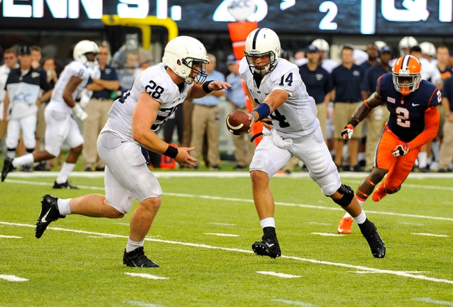 Aug 31, 2013; East Rutherford, NJ, USA; Penn State Nittany Lions quarterback Christian Hackenberg (14) prepares to hand the ball off to running back Zach Zwinak (28) during the fourth quarter against the Syracuse Orange at MetLife Stadium.  Penn State defeated Syracuse 23-17.  Mandatory Credit: Rich Barnes-USA TODAY Sports