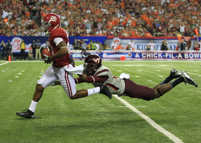 Aug 31, 2013; Atlanta, GA, USA; Alabama Crimson Tide wide receiver Christion Jones (22) catches a 38yard touchdown pass past Virginia Tech Hokies safety Desmond Frye (26) in the third quarter of the 2013 Chick-fil-a Kickoff game at the Georgia Dome. Mandatory Credit: Daniel Shirey-USA TODAY Sports