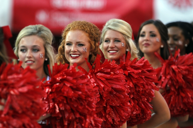 Aug 31, 2013; Lincoln, NE, USA; Nebraska Cornhuskers cheerleaders line up for the national anthem prior to the game against the Wyoming Cowboys at Memorial Stadium. Mandatory Credit: Bruce Thorson-USA TODAY Sports