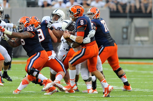 Aug 31, 2013; East Rutherford, NJ, USA; Syracuse Orange quarterback Drew Allen (8) is sacked by Penn State Nittany Lions safety Stephen Obeng-Agyapong (7) during the fourth quarter at MetLife Stadium.  Penn State defeated Syracuse 23-17.  Mandatory Credit: Rich Barnes-USA TODAY Sports
