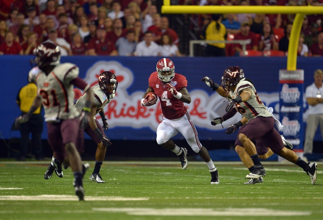 Aug 31, 2013; Atlanta, GA, USA; Alabama Crimson Tide running back T.J. Yeldon (4) runs against the Virginia Tech Hokies during the fourth quarter of the 2013 Chick-fil-A Kickoff game at the Georgia Dome. Mandatory Credit: Paul Abell-USA TODAY Sports