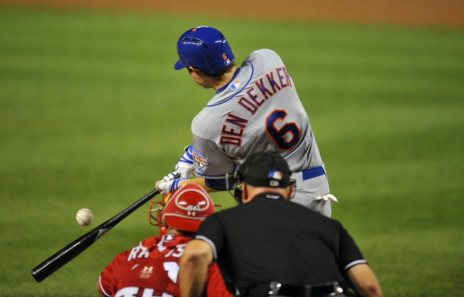 Aug 31, 2013; Washington, DC, USA; New York Mets center fielder Matt den Dekker (6) gets his first career major league hit in the third inning in the third inning against the Washington Nationals at Nationals Park. Mandatory Credit: Joy R. Absalon-USA TODAY Sports