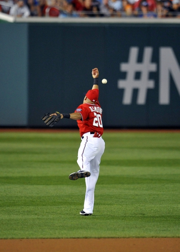 Aug 31, 2013; Washington, DC, USA; Washington Nationals shortstop Ian Desmond (20) cannot catch a ball hit by New York Mets center fielder Matt den Dekker (not shown) in the third inning at Nationals Park. Mandatory Credit: Joy R. Absalon-USA TODAY Sports