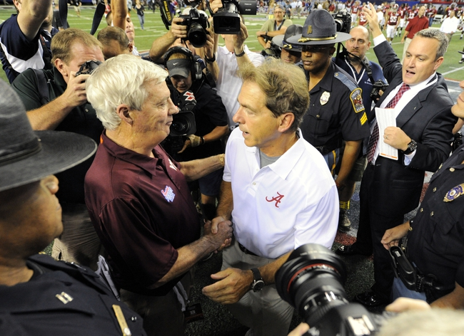 Aug 31, 2013; Atlanta, GA, USA; Alabama Crimson Tide head coach Nick Saban (right) shakes hands with Virginia Tech Hokies head coach Frank Beamer after the 2013 Chick-fil-A Kickoff game at the Georgia Dome. Alabama won 35-10.  Mandatory Credit: Dale Zanine-USA TODAY Sports