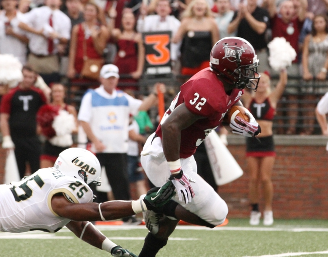 Aug 31, 2013; Troy, AL, USA;  UAB Blazers linebacker Destin Challenger (25) reaches for Troy Trojans running back Brandon Burks  (32) during the first half at Veterans Memorial Stadium. Mandatory Credit: Marvin Gentry-USA TODAY Sports