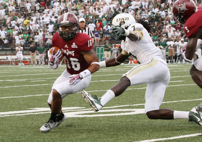 Aug 31, 2013; Troy, AL, USA;  Troy Trojans wide receiver Chandler Worthy (16) carries the ball as UAB Blazers cornerback Jimmy Jean (7) pursues him at Veterans Memorial Stadium. Mandatory Credit: Marvin Gentry-USA TODAY Sports