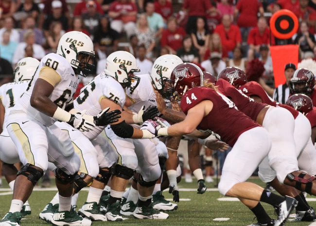 Aug 31, 2013; Troy, AL, USA;  UAB Blazers offensive line prepare to block the Troy Trojans defense at Veterans Memorial Stadium. Mandatory Credit: Marvin Gentry-USA TODAY Sports