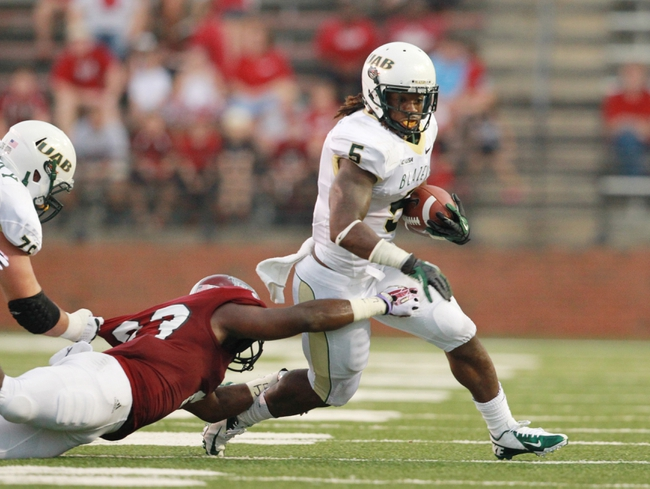 Aug 31, 2013; Troy, AL, USA;  UAB Blazers running back Darrin Reaves (5) is grabbed by Troy Trojans linebacker Wayland Coleman-Dancer (23) at Veterans Memorial Stadium. Mandatory Credit: Marvin Gentry-USA TODAY Sports