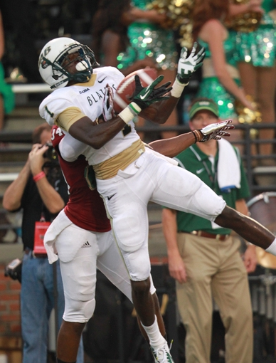 Aug 31, 2013; Troy, AL, USA; UAB Blazers wide receiver Jamarcus Nelson (1) catches the ball for a touchdown as Troy Trojans cornerback Ethan Davis (34) defends  at Veterans Memorial Stadium. Mandatory Credit: Marvin Gentry-USA TODAY Sports