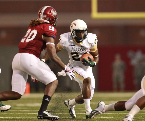 Aug 31, 2013; Troy, AL, USA;  UAB Blazers running back Greg Franklin (24) carries the ball against the Troy Trojans at Veterans Memorial Stadium. Mandatory Credit: Marvin Gentry-USA TODAY Sports